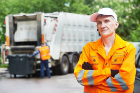 picture of recycle bin  - Portrait of municipal worker recycling garbage collector truck loading waste and trash bin - JPG
