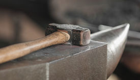 stock photo of blacksmith shop  - Hammer and Anvil - Tools for blacksmithing ** Note: Shallow depth of field - JPG