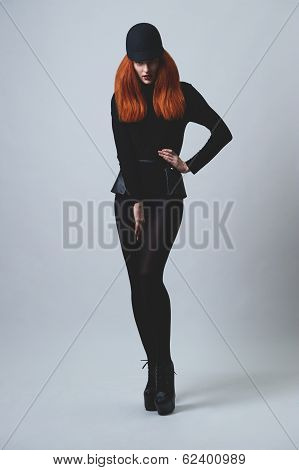 red haired horsewoman on high heels