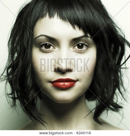 Young Beautiful Woman With Strict Hairstyle