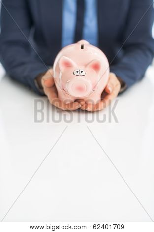 Closeup On Business Woman Holding Piggy Bank