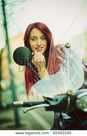 Fixing makeup on motorcycle