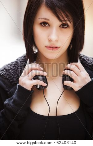 Young beautiful pierced girl with headphones.