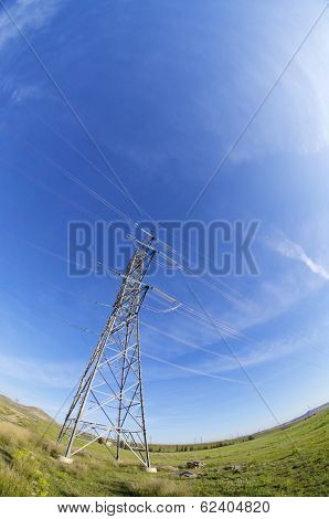 High tension electrical tower and blue sky.