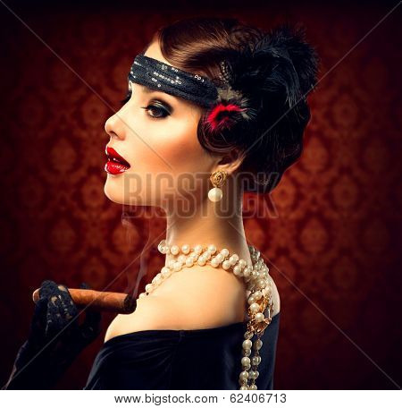 Retro Woman Portrait. Vintage Styled Girl With Cigar. Smoking Lady. Vintage Styled Photo. Old Fashioned Makeup and Finger Wave Hairstyle. 20's or 30's style.