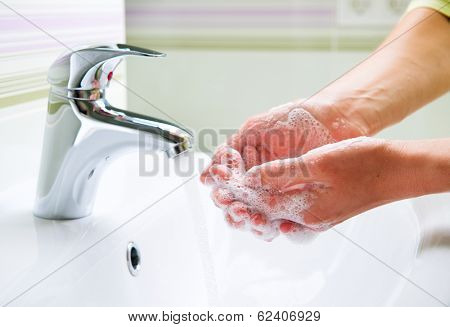 Washing Hands with soap. Woman Cleaning Hands in a bathroom. Hygiene
