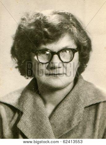 LODZ, POLAND, CIRCA 1960's: Vintage portrait of woman in glasses