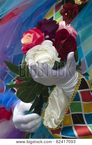 Venetian Masquarade Performance With Roses Bouquete