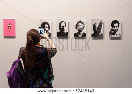 Woman Taking A Picture At Miart 2014 In Milan, Italy