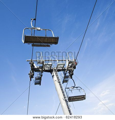 Chairlift in a blue sky background