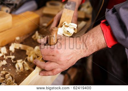 Planer At Work In Rugged Male Hands