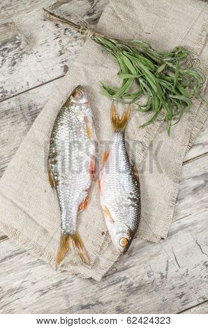 Two Roaches Fish On A Linen Napkin.