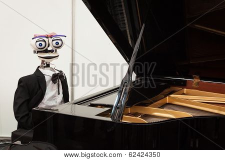 Robot Playing Piano At Robot And Makers Show