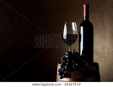 Juicy grape and wine with barrel