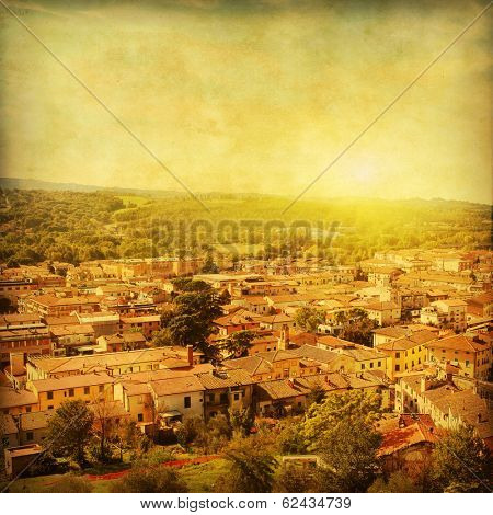 View of small town Certaldo, Tuscany, Italy. Grunge and retro style.