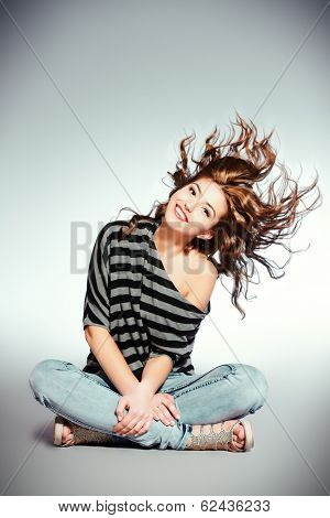 Beautiful smiling girl with fresh pure skin and beautiful hair in motion.