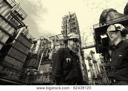 oil and gas workers inside large chemical refinery industry
