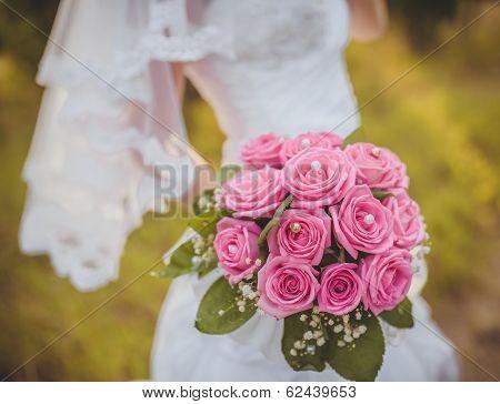 wedding bouquet in hands of the brid