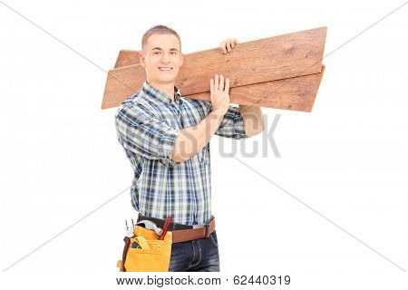 Male carpenter carrying planks over his shoulder isolated on white background