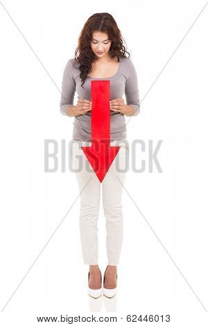 full length portrait of woman holding red arrow pointing down