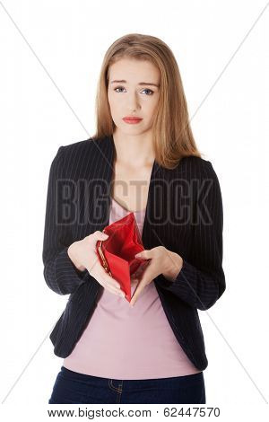 Business woman is showing her empty wallet. Isolated on white.