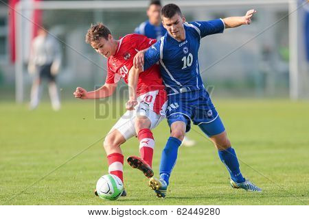 TRAISKIRCHEN, AUSTRIA - JUNE 5  Louis Schaub (#20 Austria) and Amar Rahmanovic (#10 Bosnia and Herzegovina) fight for the ball during the U19 game on June 5, 2013 in Traiskirchen, Austria.
