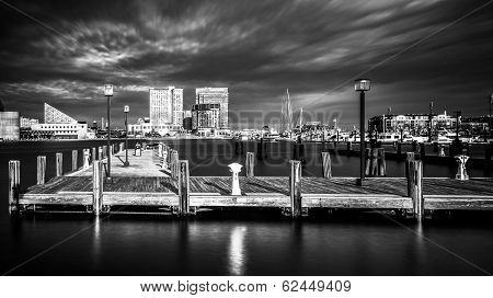 Long Exposure Of A Pier And The Inner Harbor In Baltimore, Maryland.
