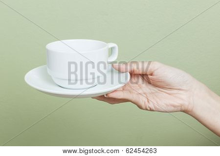 Cup Of Tea Or Coffee In Hand