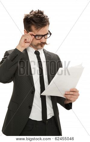 Businessman Examining Papers