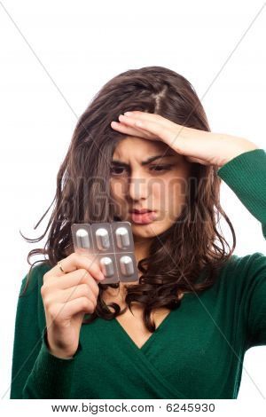 Young Woman With Migraine, Holding Pills