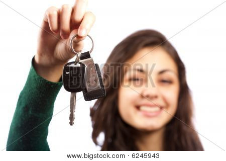Young Sales Lady Offering Car Keys