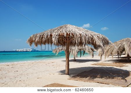 Straw beach umbrellas at a tropical resort