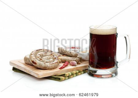Grilled sausages with ketchup, mustard and mug of beer. Isolated on white background