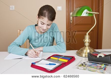 Writing Young Woman At Desk