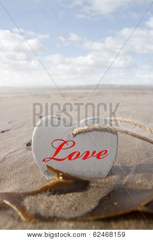 Inscribed Wooden Love Heart In The Sand