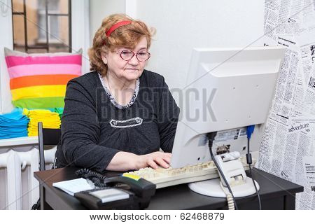 Senior Woman Typing Keyboard Button On Computer