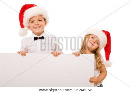 Kids With Santa Hats And White Banner For Text