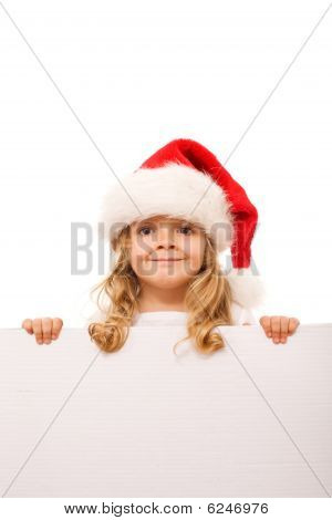 Little Girl With Santa Hat And Cardboard Banner