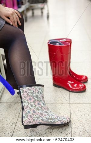 Dressing And Buying Rainboots In Shoeshop