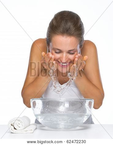 Happy Young Woman Washing Face