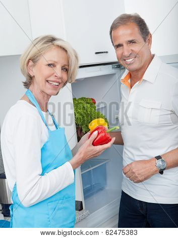 Mature Couple Holding Vegetables