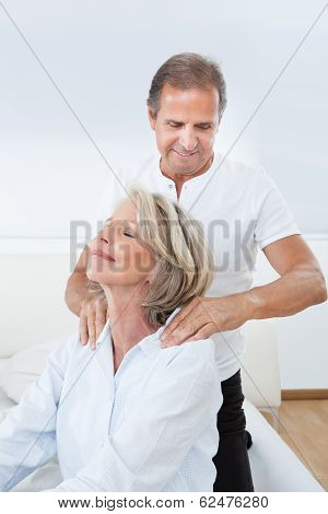 Man Massaging Woman's Shoulder