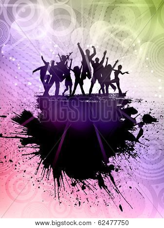 Silhouette of a grunge party crowd on an abstract background