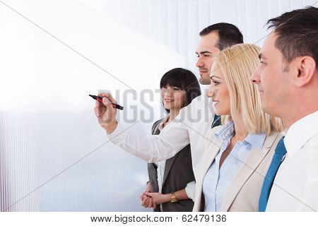 Business Man Writing On White Board
