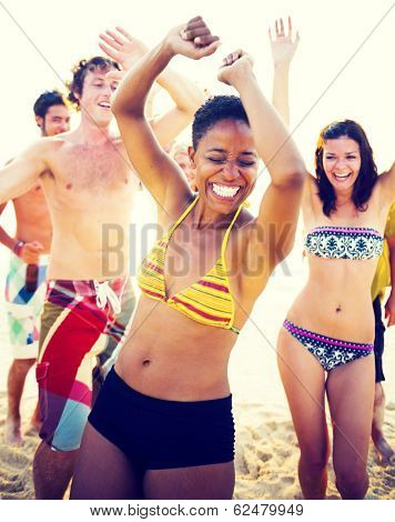 Group of people partying on the beach.