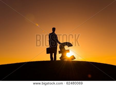 Silhouette of Businessman and Pound Currency