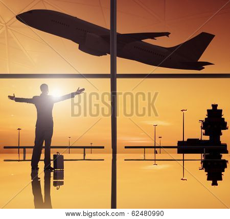 Silhouettes of business and airplane in airport