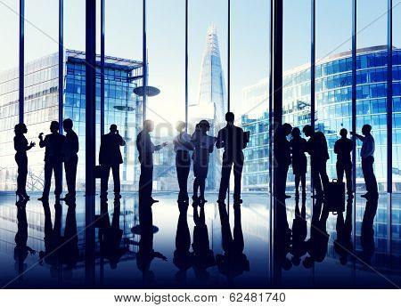 Silhouettes Of Multi-Ethnic Group Of Business People Working Together Indoors