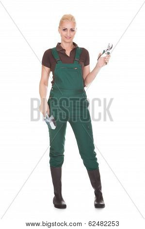 Portrait Of A Female Worker Holding Worktool