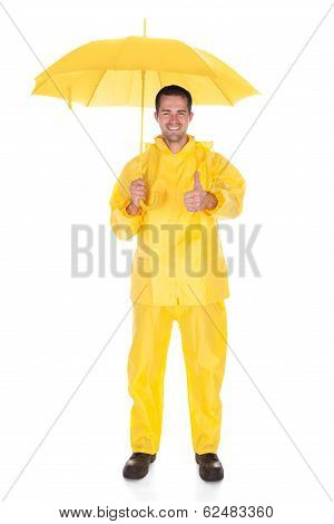 Mature Man Wearing Raincoat And Holding Umbrella